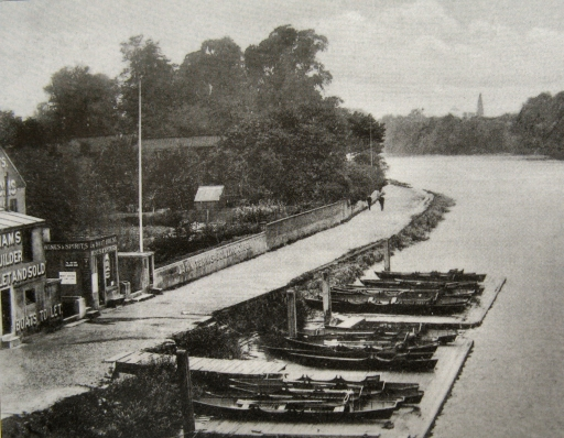 Boats lined up by Kew Bridge